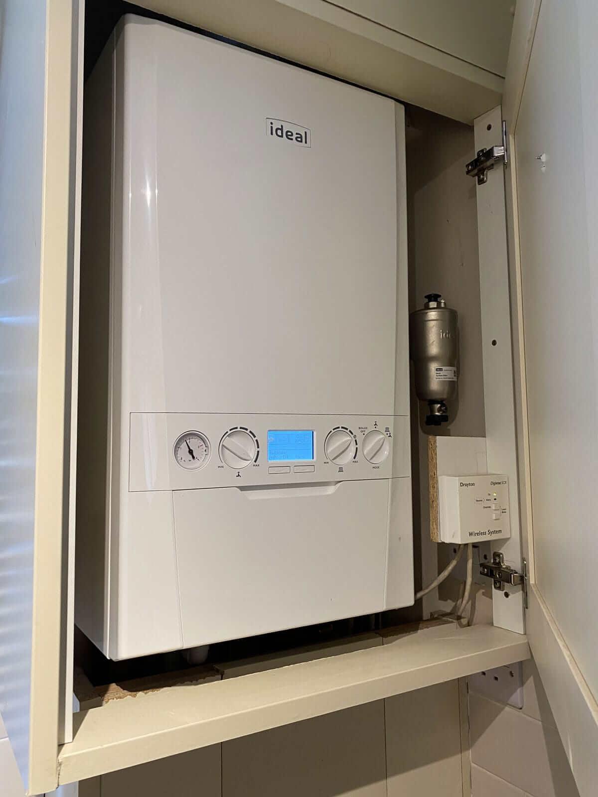 Homeowner Checking Boiler